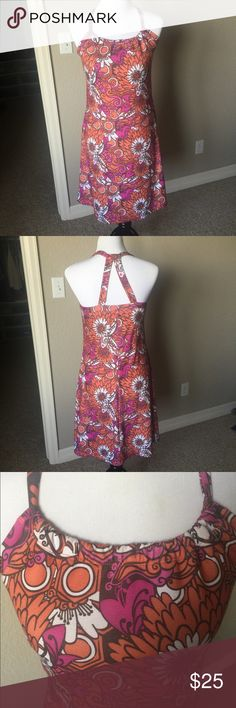 PrAna Dress PrAna Dress made w stretchy  fabric . Has a scoop-neck design, unique double-strap racerback style, and an internal shelf bra for added support. This dress has been worn and has minimal pilling. See photos. Pink, Orange , white and brown. Pretty floral design. Prana Dresses Midi
