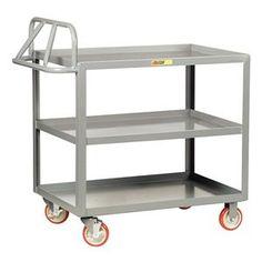 "Ergo Shelf Truck, Lip Up, 3 shelves, 48x24 by Little Giant. $481.67. Ergonomic Shelf Trucks5"" polyurethane casters (2 rigid, 2 swivel w/brakes) Load capacity: 1200 lb. 12-ga. steelErgonomic Shelf Truck, Lip Up Shelves, Load Capacity 1200 lb., Welded Steel Construction, Gauge Thickness 12, Powder Coat Finish, Color Gray, Overall Length 54 In., Overall Width 24 In., Overall Height 42 In., Number of Shelves 3, Caster Size 5 In., Caster Type 2 Rigid, 2 Swivel With Brake, Caster Ma..."