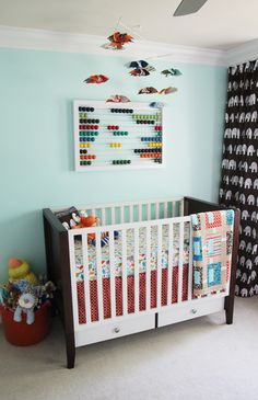 The bright colors and patterns in this space work so well together. I love the window nook and the diy feel of the entire nursery.