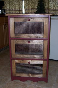 Veggie Bin! Just replace the front wood piece of the drawers with wire mesh/screen! Genius!
