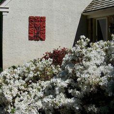 Handmade, sgraffito-carved ceramic wall tile by Natalie Blake Studios