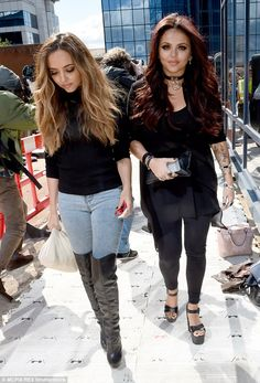 On the campaign trail: Bandmates Jade Thirlwall (left) and Jesy Nelson (right) followed closely behind
