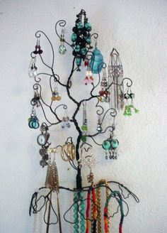Wall mounted wire jewelry tree.