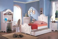 niñas habitacion pared azul muebles madera ideas