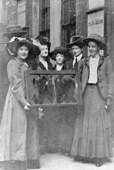 Suffragettes proudly hold up a smashed window. Suffragettes, Broken Window, Hold On, Movie Posters, Painting, Film Poster, Naruto Sad, Popcorn Posters, Painting Art