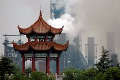 This photograph shows the juxtaposition of the old and traditional aspects of Asian architecture and way of life. Behind the traditional looking pagoda sits an industrial manufacturing plant with smog pumping put if it. This shows a contrast in the old and new aspects of culture and how surprisingly different they appear when placed next to each other.
