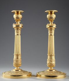 Pair of large gilt bronze candlesticks. Each candlesticks has a circular base decorated with winged female holding wreaths and floral on a matt background. The stem is partly fluted, its. Candlestick Holders, Candlesticks, Antique Lamps, Oil Lamps, Restaurant, Art Nouveau, Chandelier, Bronze, Lights