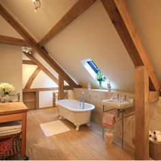 I want to have useable attic space where I can relax and hide from the world! I love the claw-footed bath, water basin under the sink and slanted window.