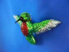 Ruby throated Hummingbird glass Christmas ornament. It is good luck to have a bird on your tree and I can't find a cuter ornament.