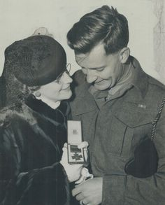 Major David Currie, home after 28 months over seas, shows his wife. George Cross, George Santayana, The Blitz, Toronto Star, Civil Rights Movement, Royal Air Force, King George, Seas, Wedding Couples