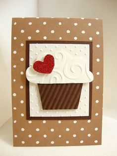 cupcake with embossed icing, dots on dots and bright red heart to set it off. cute and easy!