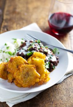 These simple garlic tostones are Puerto Rican fried plantains with a little sea salt are the perfect golden crispy addition to a plate of rice and beans.