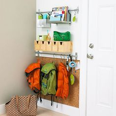 The rail system makes for great vertical organization in a small entryway. The combination of hooks, shelves, drawers, and bins means all your items will have a home. And we love the adition of cork tiles to the back of the wall — a great place to stick artwork, school notes, and birthday invitations.