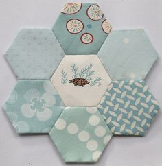 Blue hexies by clair101, via Flickr, with Aneela Hoey for Moda tortoise fabric
