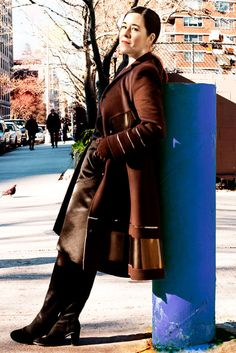 Double-faced wool and patent leather coat and duchess satin wrap skirt by Ralph Rucci