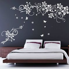 flower and butterfly vine wall stickers by parkins interiors   notonthehighstreet.com