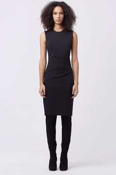 The DVF Glennie features a flattering cinched waist and falls to the knee.