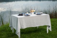 Light grey washed linen tablecloth. It features softness, gentleness.  #linentablecloth #washedlinen