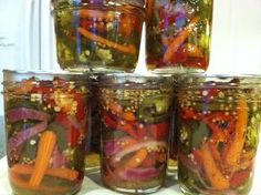 Happy Trails Candy    1 1/2 lb fresh jalapenos   1 cup sliced carrots (lengthwise or circles)  4 medium red peppers (sweet or hot - not bell)  1 small onion - halved then sliced  2 cup cider vinegar  4 cups sugar  3 tablespoons mustard seed  2 tablespoon garlic powder