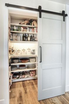 Modern pantry design with an elegant sliding barn door [Design: Dwellings Design. Kitchen Pantry Design, Smart Kitchen, Home Decor Kitchen, Awesome Kitchen, Kitchen Storage, Kitchen Ideas, Barn Door Pantry, Pantry Room, Small Pantry Closet