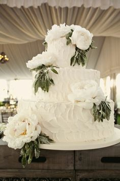 sugared leaves elegant celebration cake . Alejandra poupel events loves the flowers and the white monochrome elegant design