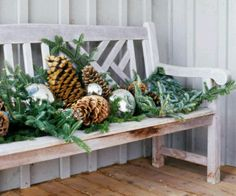 Holiday Bench Decor Give a bench some holiday spirit with an arrangement of holiday greenery, pinecones, gazing balls, and ornaments. Spray the arrangement with a light dusting of fake snow for extra winter flair. Christmas Greenery, Christmas Porch, Noel Christmas, Winter Christmas, Christmas Lights, Christmas Crafts, Winter Porch, Country Christmas, Christmas Ideas