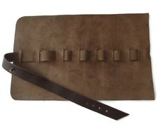 Roll up pencil case in brown italian leather.  This genuine leather case is a stylish way to hold your writing instruments, pens, pencils. The leather is soft but offers a perfect protection for...