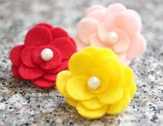 Felt flowers are simple to make and they make a great accessory! You can glue a hair clip or ponytail holder to the back, or sew or clip them onto a headband. Very cute for little girls and you can make a variety of colors to match different outfits. Of course I made these with …