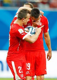 Xherdan Shaqiri and Josip Drmic of Switzerland celebrate victory after  the 2014 FIFA World Cup Brazil Group E match between Honduras and Switzerland at Arena Amazonia on June 25, 2014 in Manaus, Brazil.