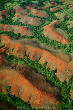 Eroding hills with forested valleys, aerial view, western Madagascar.