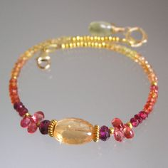 Hey, I found this really awesome Etsy listing at https://www.etsy.com/listing/237536504/slender-pink-orange-beaded-gemstone