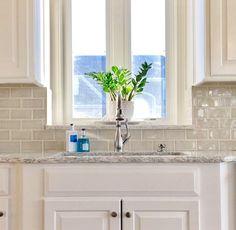 """Kitchen remodel!   White kitchen. Cabinet Color: Benjamin Moore """"White Dove"""" Backsplash: Soci """"Cappuccino"""" Countertop: Cambria quartz """"Berwyn"""" Sink: Blanco """"cinder"""" Faucet: Delta"""
