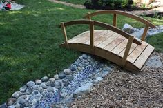 bridge over creek bed -- way to avoid covering the whole yard in grass (which proving difficult at best)
