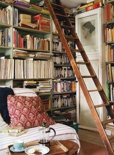 We love this reading nook filled with floor-to-ceiling bookshelves. Virginia Woolf would approve!