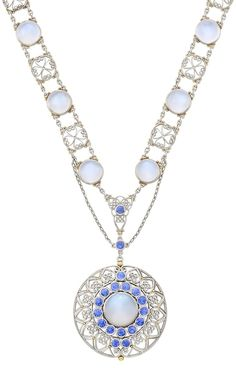 A Belle Epoque Platinum, Gold, Moonstone and Sapphire Necklace, Tiffany & Co., Louis Comfort Tiffany for Tiffany, circa 1915. 19 round cabochon moonstones, 18 round sapphires ap. 1.75 cts., signed Tiffany & Co. #Tiffany #BelleEpoque #vintage #necklace