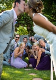 Everyone is shocked in between the Bride & Groom Photo by Becky Fluery