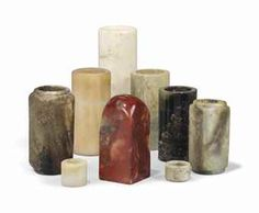 A COLLECTION OF NINE SOAPSTONE AND HARDSTONE CARVINGS