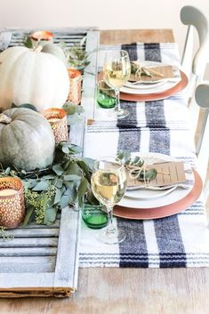 Beautiful rustic farmhouse style Thanksgiving table setting idea with blue stripe linens and pumpkin centerpiece. Beautiful rustic farmhouse style Thanksgiving table setting idea with blue stripe linens and pumpkin centerpiece. Thanksgiving Table Settings, Thanksgiving Tablescapes, Thanksgiving Decorations, Outdoor Thanksgiving, Hosting Thanksgiving, Thanksgiving Recipes, Fall Home Decor, Autumn Home, Holiday Decor