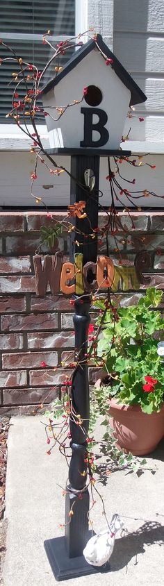 One old stair rail, a new bird house, some paint, berries, and lights and you have yourself a cute little welcome post. Try it!