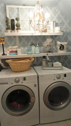 11 Magnolia Lane's small laundry room is updated with cafe shelving, a sweet chandelier, and painted wallpaper--it almost makes me want to do a load of laundry!