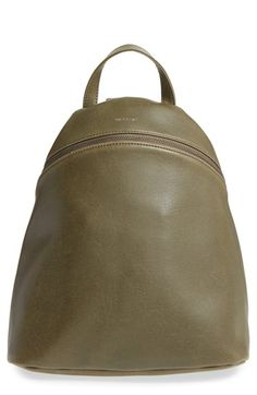 Free shipping and returns on Matt & Nat 'Aries' Vegan Leather Backpack at Nordstrom.com. A small-scale backpack in high-quality vegan leather features a structured silhouette that holds its shape when you set it down, making it simple to find belongings inside and less likely to spill. A top handle and adjustable backpack straps make it easy to carry, and the attractive dark green lining is completely made from recycled plastic bottles.