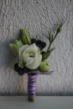 Ranunculus boutonniere w/ lisianthus buds (gold ribbon for us and maybe eucalyptus filler?)