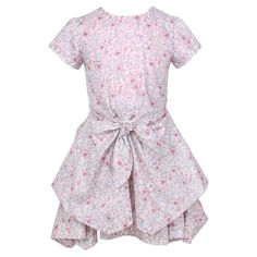 Jessie & James girls beautiful short sleeved dress made from soft, lightweight cotton with an all over pink Liberty Monroe Flower print. In a clever and flattering style, the skirt has layers of different lengths creating a full, girly handkerchief look, with a tied bow at the front and button detail on the back.<br /> <ul> <li>100% cotton (soft, fine and lightweight)</li> <li>Machine wash (30*C)</li> <li>Designer colour: Liberty Monroe Flower</li> </ul>