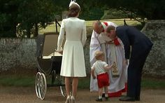 Prince William has a word with Prince George (who didn't want to go into the church) before the christening