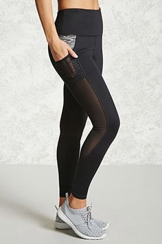A pair of knit athletic capri leggings featuring sheer mesh side panels, a hidden key pocket, seam-stitched panels, and moisture management.