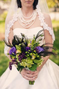 i like the use of feathers in this bouquet