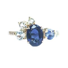 MOCIUN custom Blue Sapphire Stone Cluster Ring with aqua and white diamonds set in 14K yellow gold.