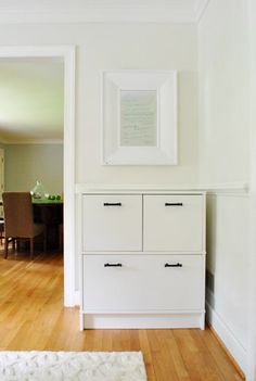 love the cabinet with filing drawers beneath. Perfect for our office (in brown-black of course)
