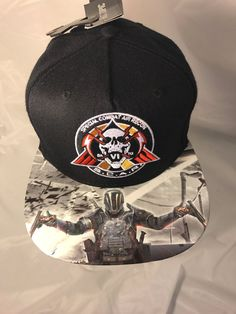 Call of duty has capsized with this custom one-of-a-kind gamer envy piece! That's right envy piece. One of one you get to have the gaming rights to say you were the only one in the world with this cap! Yes not only are you paying for the awesome hand applied bad ass image on the brim, you're paying for the bragging rights...    This cap was made to be a single edition piece. The only one in the world.  Exclusivly engineered by Tatts4Hats creator. You will receive a Certificate of…