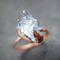 We finished a couple rough gemstone rings today. This one is aquamarine in recycled rose gold. #showmeyourrings #somethingblue #aquamarine